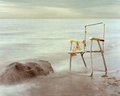 Free Old Lawn Chair And Rock By Water. Royalty Free Stock Photography - 28792337