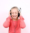 Free Blond Girl Listens To Music With Headphones And Laughs Royalty Free Stock Image - 28795936