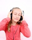 Free Blond Happy Girl Listening To Music With Headset Royalty Free Stock Photo - 28796125