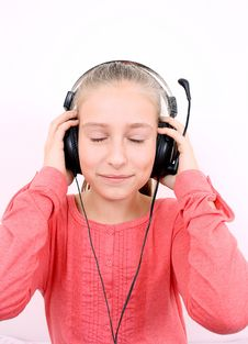 Free Blond Girl Listening To Music With Headset And Is Looking Forward Stock Photo - 28796040