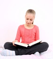 Free Blond Girl Reads Interesting Book Sitting On Bed Royalty Free Stock Photo - 28796155