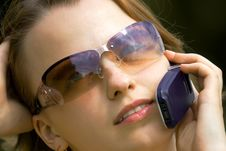 The Girl Speaking By Phone Royalty Free Stock Photography