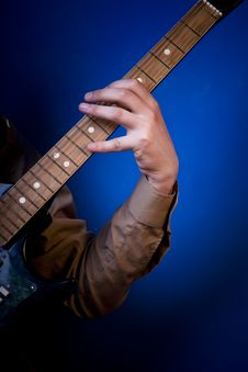 Hand On Guitar Fretboard Royalty Free Stock Photos