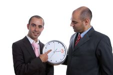 Two Business Men Holding Clock Royalty Free Stock Image