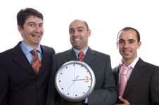 Three Business Men With Clock Stock Photo