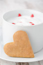 Free Cup Of Hot Milk With Foam, Decorated With Sugar Hearts And Heart Royalty Free Stock Photo - 28818345