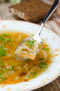 Free Spoon Of Chicken Soup With Noodles And Carrots Closeup Vertical Royalty Free Stock Photos - 28819018