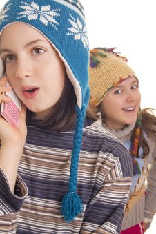 Beautiful Young Girl In Warm Winter Clothes Speaking On A Mobile Royalty Free Stock Photo
