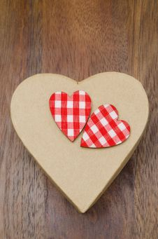 Free Decorative Gift Box With Hearts On A Wooden Background Stock Photos - 28818353