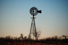 Free Bared Wire Fence And Water Windmill Royalty Free Stock Photography - 28818667