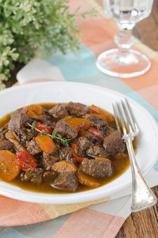 Stew Of Beef With Vegetables And Prunes In A Plate, Vertical