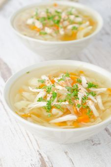 Free Two Bowls Of Vegetable Soup With Chicken And Parsley Royalty Free Stock Image - 28819156