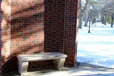 Free Stone Seat In Curve Of Brick Wall Stock Images - 28821874