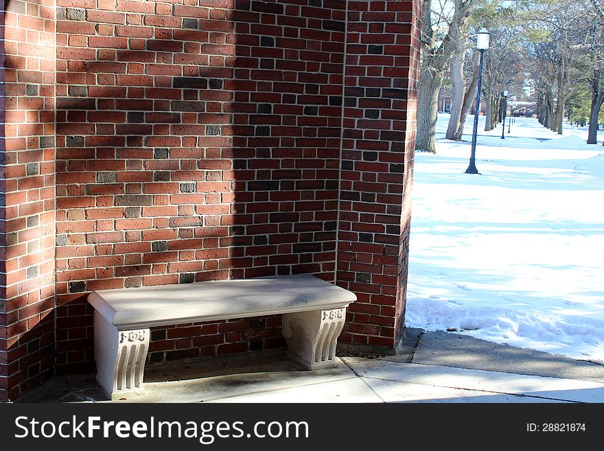Stone seat in curve of brick wall
