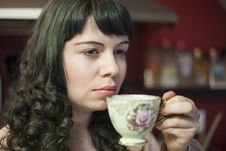Young Woman With Antique Tea Cup Royalty Free Stock Images