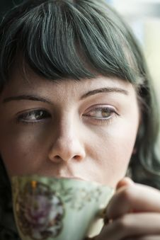 Young Woman With Antique Tea Cup Royalty Free Stock Image