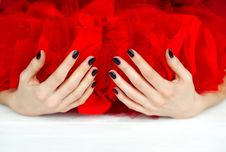 Free Hands With Dark Manicure And Red Veiling Stock Image - 28840541