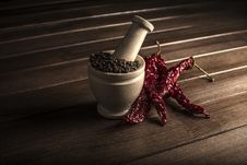Marble Mortar With Spices Black Pepper And Red Hot Pepper Royalty Free Stock Photos