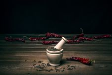 Marble Mortar With Spices Black Pepper, Carnation And Red Hot Pepper Royalty Free Stock Images