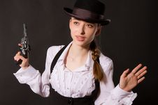 Portrait Of Beautiful Young Woman With A Gun. Stock Images
