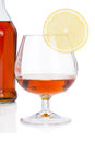 Free Glass Of Cognac With Bottle On White Royalty Free Stock Image - 28876746