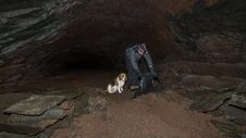 Free A Man And A Dog In A Cave. Royalty Free Stock Photography - 28881447