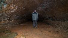 Free A Man Walking In A Cave. Royalty Free Stock Photography - 28881457