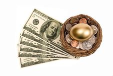 Golden Nest Egg Shown With Lots Of Money Royalty Free Stock Images