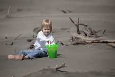 Free Cute Blonde Child Playing At The Beach Stock Photography - 28886912