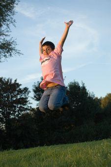 Boy Cheerfull Jumping Royalty Free Stock Photography