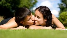 Free Happy Couple Lying On Grass. Royalty Free Stock Photos - 2898468