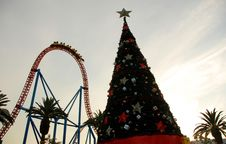 Free Christmas Tree With A Roller Coaster In The Background Royalty Free Stock Images - 28929199