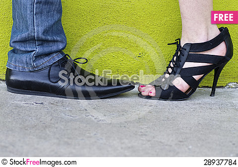 Free His & Her Shoes Against A Chartreuse Wall Stock Images - 28937784