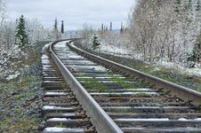 Free Railroad Amongst Snowy Forest. Royalty Free Stock Photos - 28930038