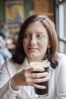 Free Young Woman With Beautiful Brown Eyes Drinking A Pint Of Stout Stock Images - 28942894