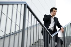 Young Businessman, In An Office Building Talking On The Phone Stock Images