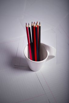 Black And Red Pencils Stand Royalty Free Stock Photo