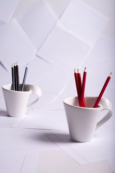 Black And Red Pencils Stand In Two Cups Royalty Free Stock Images