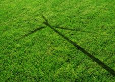 Free Wind Generator Turbine Shadow On The Grass Royalty Free Stock Photo - 28955365