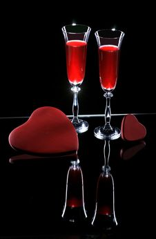 Two Wine Glasses And Hearts