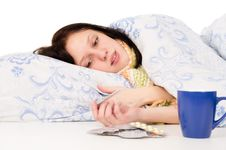 Free The Diseased Girl Lying In Bed, Drinking Tea Stock Images - 28984124