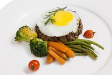 Free Patty, Cooked Vegetables And Fried Eggs Stock Image - 28990941