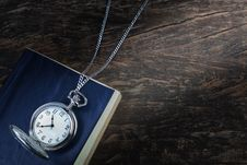 Free Pocket Watch On An Old Book, A Notebook. Stock Photo - 28991770