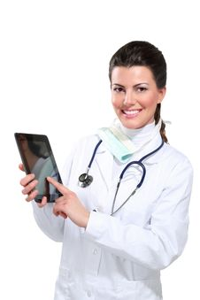 Young Beautiful  Woman Doctor With Tablet Royalty Free Stock Images
