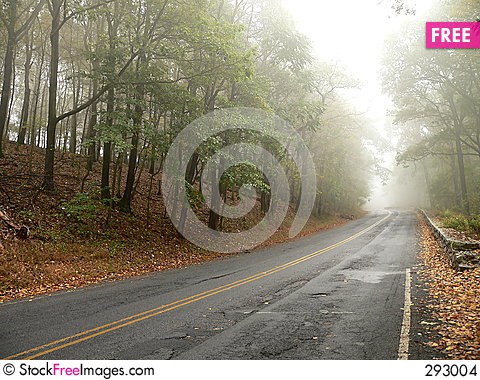 Road disappears in the Mist Stock Photo