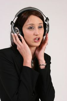 Businesswoman Listening To Her Favorite Music Royalty Free Stock Photography