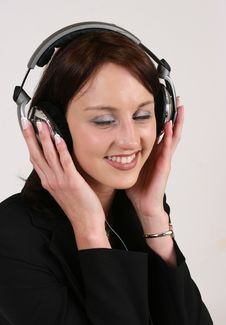 Businesswoman Listening To Her Favorite Music Stock Image