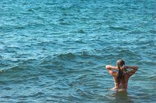 Female Torso On Sea Backgroung Stock Photos