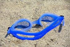 Goggles In The Sand Stock Photos