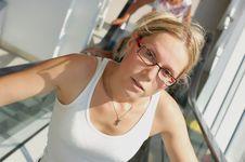Woman On Escalator Royalty Free Stock Photo